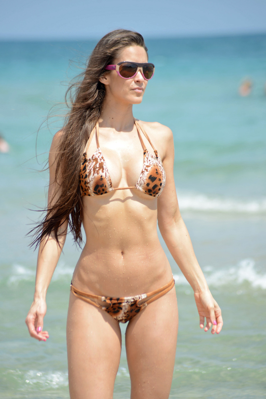 EXCLUSIVE: Model Anais Zanotti turns heads as she rocks a skimpy bikini on the beach in Miami