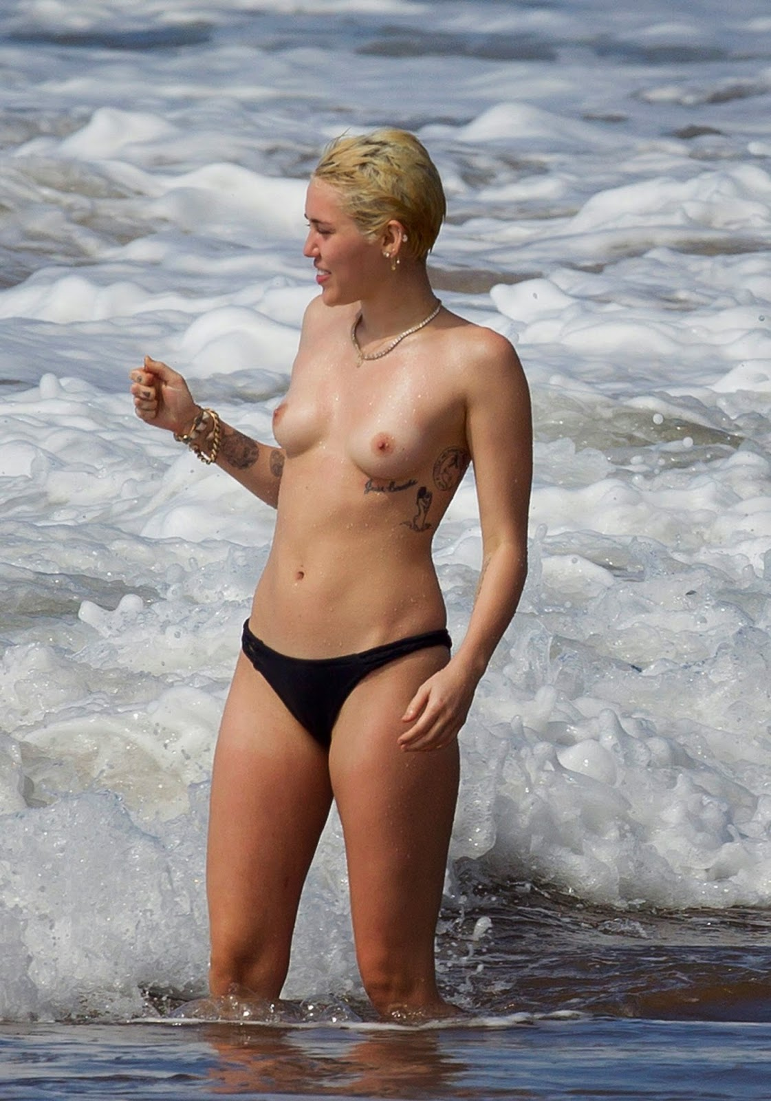 Miley Cyrus topless 2